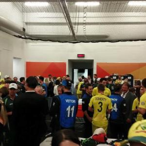 Australia and New Zealand teams mix with another, the media and officials after the World Cup final.